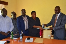 CAOS Michael Wanje and Stella Abyeto during handover ceremony at Planning Unkit Board Room